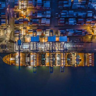 Aerial top view container cargo ship working at night, Business logistic and transportation of International by ship in the open sea.